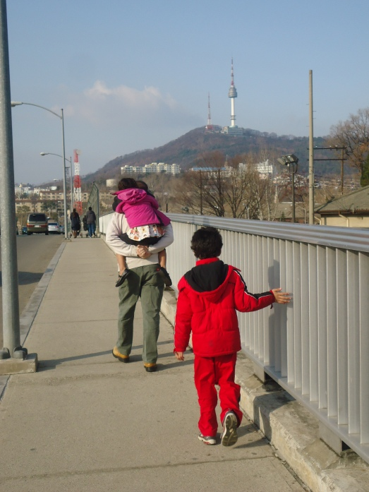 Crossing the bridge from one side of post to the other.  See Seoul Tower in the back ground?